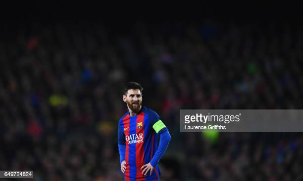Lionel Messi of Barcelona looks on during the UEFA Champions League Round of 16 second leg match between FC Barcelona and Paris SaintGermain at Camp...