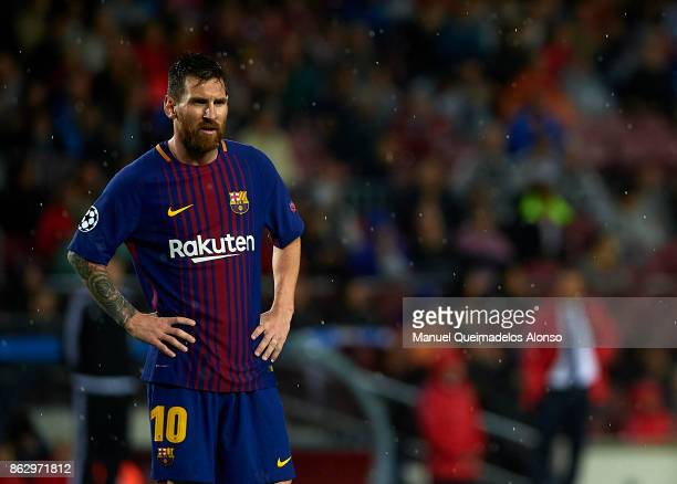 Lionel Messi of Barcelona looks on during the UEFA Champions League group D match between FC Barcelona and Olympiakos Piraeus at Camp Nou on October...