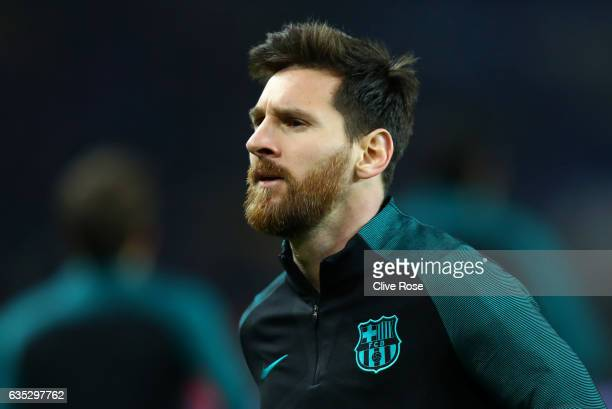 Lionel Messi of Barcelona looks on during the warmup before the UEFA Champions League Round of 16 first leg match between Paris SaintGermain and FC...