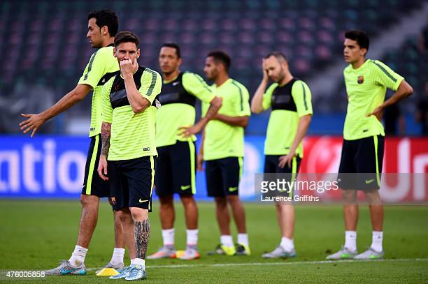 Lionel Messi of Barcelona looks on with team mates during an FC Barcelona training session on the eve of the UEFA Champions League Final match...
