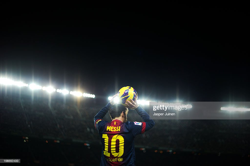 Lionel Messi of Barcelona looks to resume the game during the la Liga match between FC Barcelona and Club Atletico de Madrid at the Camp Nou stadium on December 16, 2012 in Barcelona, Spain.