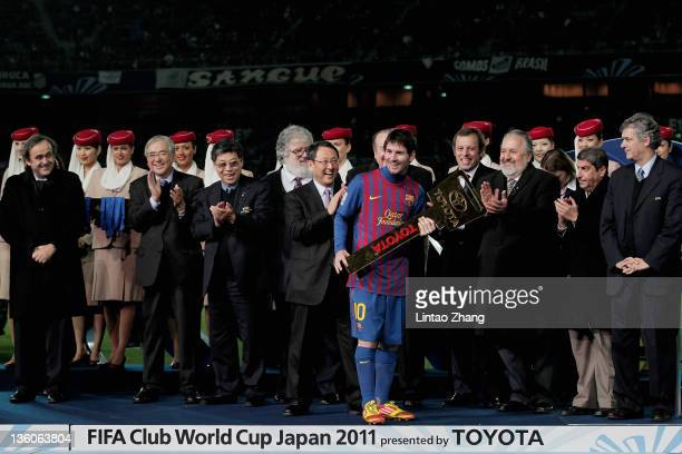 Lionel Messi of Barcelona poses with the Toyota Award the FIFA Club World Cup Final match between Santosl and Barcelona at the Yokohama International...