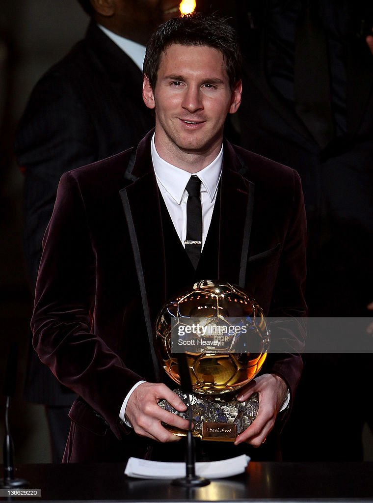 <a gi-track='captionPersonalityLinkClicked' href=/galleries/search?phrase=Lionel+Messi&family=editorial&specificpeople=453305 ng-click='$event.stopPropagation()'>Lionel Messi</a> of Barcelona receives the FIFA Ballon d'Or 2011 trophy on January 9, 2012 in Zurich, Switzerland.