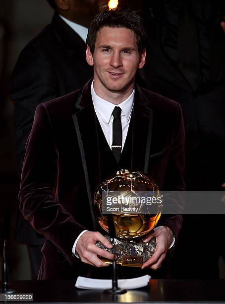 Lionel Messi of Barcelona receives the FIFA Ballon d'Or 2011 trophy on January 9 2012 in Zurich Switzerland