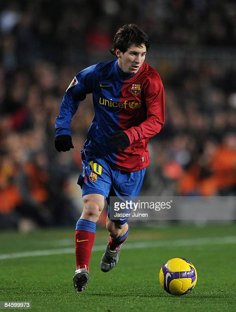 Lionel Messi of Barcelona runs with the ball during the Copa del Rey quarter final second leg match between Barcelona and Espanyol at the Camp Nou...