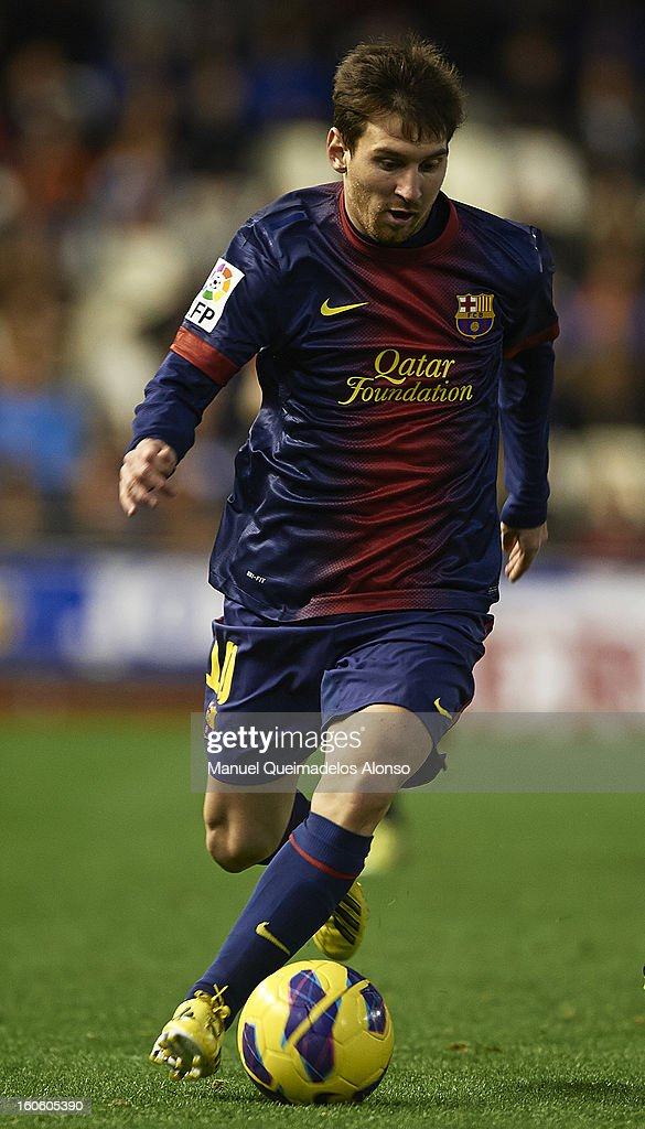 Lionel Messi of Barcelona runs with the ball during the La Liga match between Valencia and Barcelona Estadio Mestalla on February 3, 2013 in Valencia, Spain.