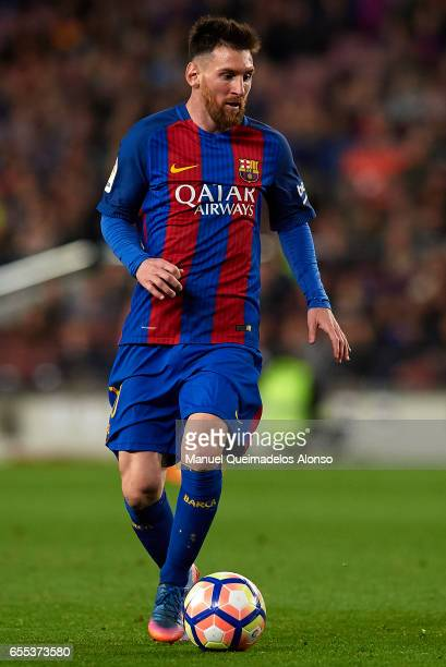 Lionel Messi of Barcelona runs with the ball during the La Liga match between FC Barcelona and Valencia CF at Camp Nou Stadium on March 19 2017 in...