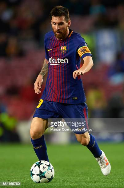 Lionel Messi of Barcelona runs with the ball during the UEFA Champions League group D match between FC Barcelona and Olympiakos Piraeus at Camp Nou...