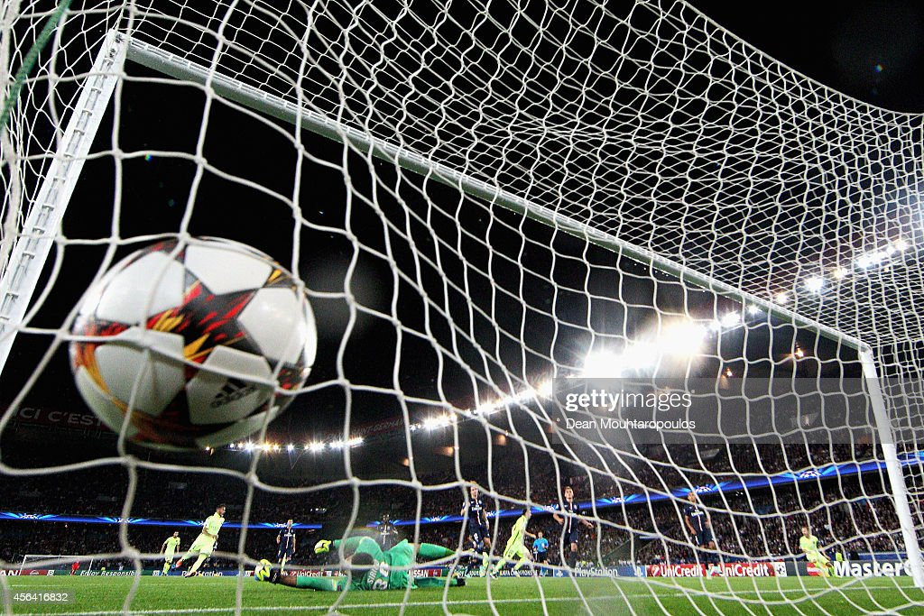 Lionel Messi of Barcelona scores his teams first goal of the game during the Group F UEFA Champions League match between Paris SaintGermain v FC...