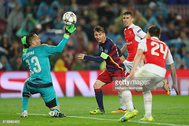 Lionel Messi of Barcelona scores his team's third goal during the UEFA Champions League round of 16 second Leg match between FC Barcelona and Arsenal...