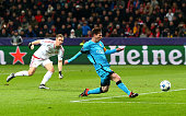 Lionel Messi of Barcelona scores the first Barcelona goal during the UEFA Champions League Group E match between Bayer 04 Leverkusen and FC Barcelona...