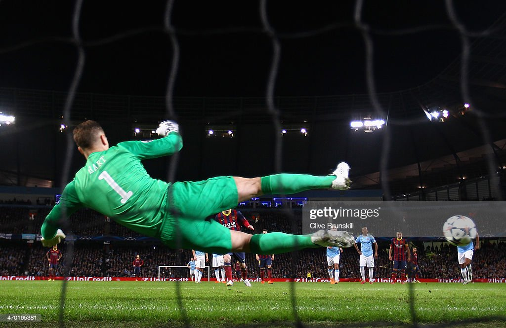 Lionel Messi of Barcelona scores the opening goal from a penalty kick during the UEFA Champions League Round of 16 first leg match between Manchester City and Barcelona at the Etihad Stadium on February 18, 2014 in Manchester, England.