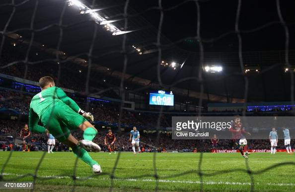 Lionel Messi of Barcelona scores the opening goal from a penalty kick during the UEFA Champions League Round of 16 first leg match between Manchester...