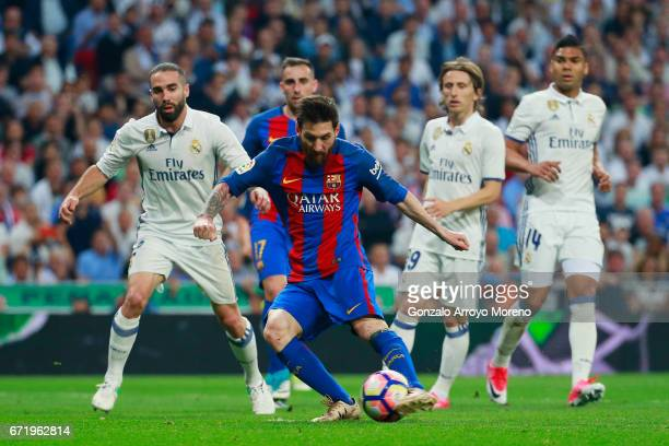 Lionel Messi of Barcelona scores their first and equalising goal during the La Liga match between Real Madrid CF and FC Barcelona at Estadio Bernabeu...