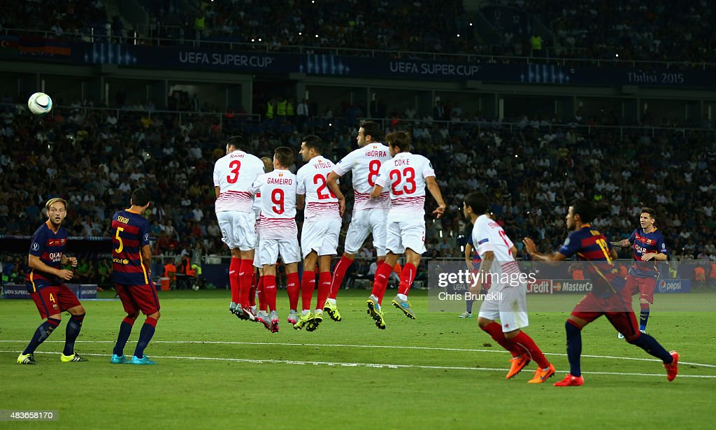 Lionel Messi of Barcelona scores their second goal from a free kick during the UEFA Super Cup between Barcelona and Sevilla FC at Dinamo Arena on...