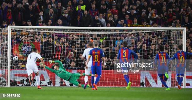Lionel Messi of Barcelona scores their third goal from a penalty past goalkeeper Kevin Trapp of PSG during the UEFA Champions League Round of 16...