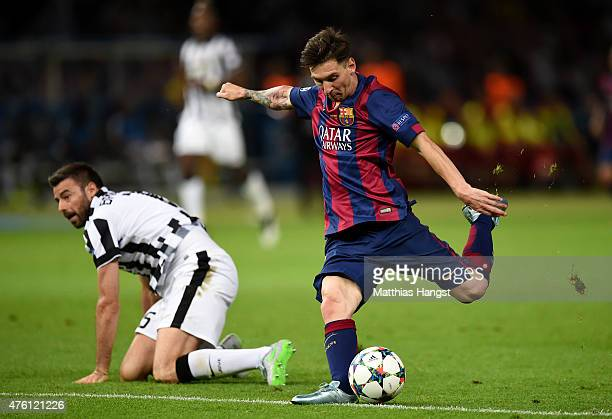 Lionel Messi of Barcelona shoots after going past Andrea Barzagli of Juventus during the UEFA Champions League Final between Juventus and FC...