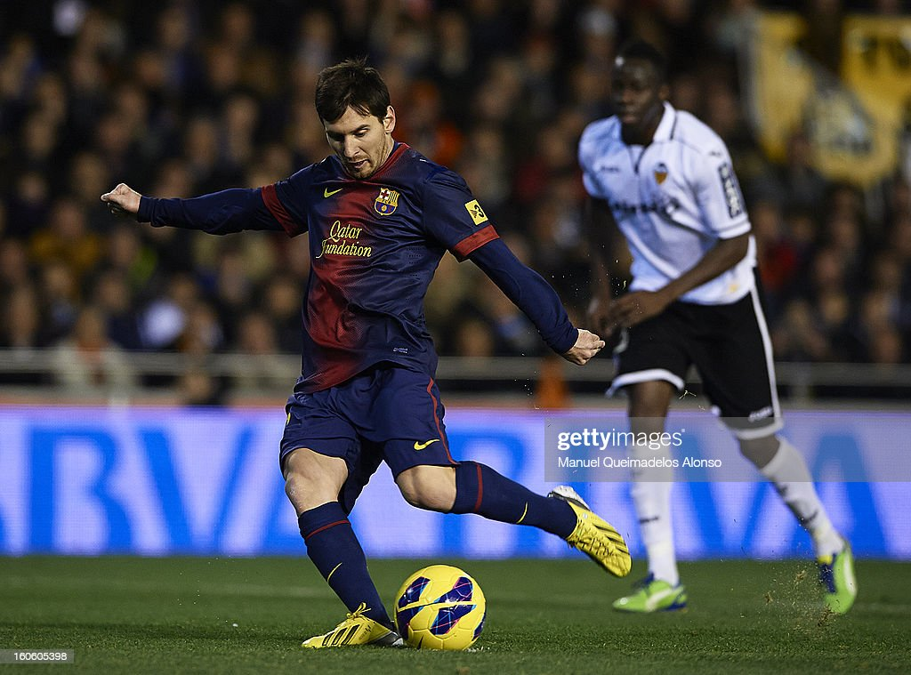 <a gi-track='captionPersonalityLinkClicked' href=/galleries/search?phrase=Lionel+Messi&family=editorial&specificpeople=453305 ng-click='$event.stopPropagation()'>Lionel Messi</a> of Barcelona shoots and scores during the La Liga match between Valencia and Barcelona Estadio Mestalla on February 3, 2013 in Valencia, Spain.