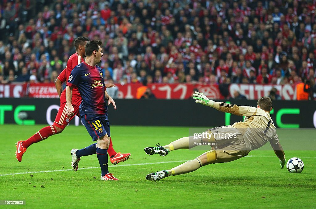 Lionel Messi of Barcelona shoots at goal as Manuel Neuer of Bayern Muenchen dives during the UEFA Champions League Semi Final First Leg match between FC Bayern Muenchen and Barcelona at Allianz Arena on April 23, 2013 in Munich, Germany.