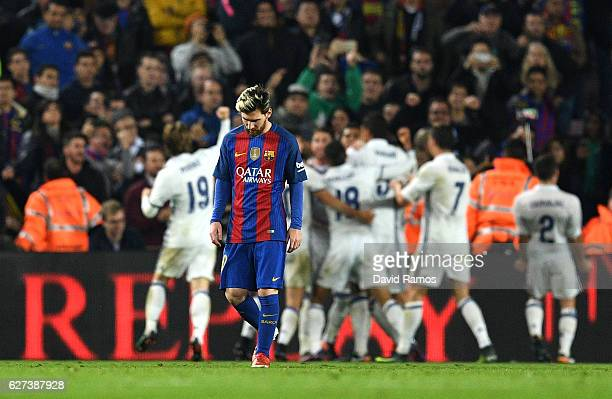 Lionel Messi of Barcelona shows his dejection after Real Madrid's equaliser during the La Liga match between FC Barcelona and Real Madrid CF at Camp...