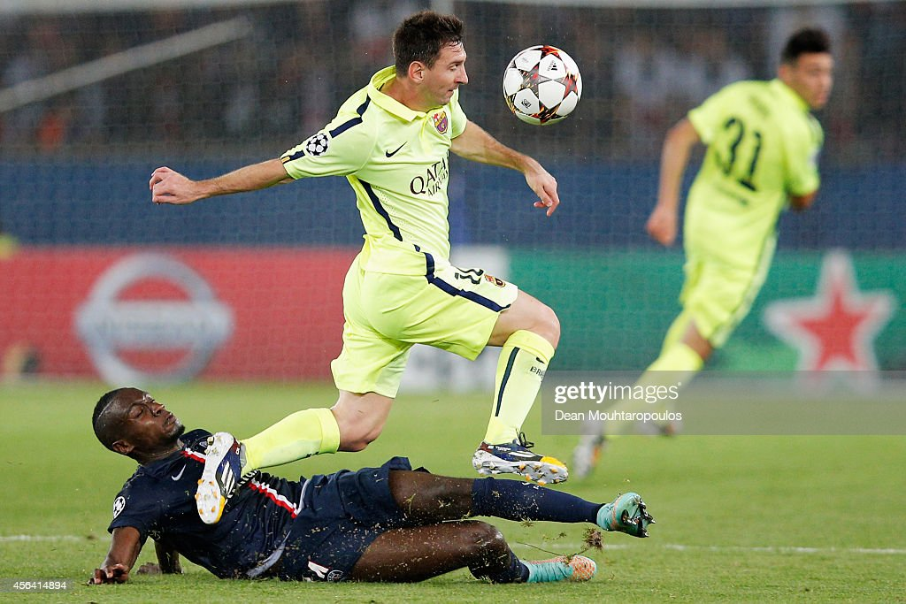 Lionel Messi of Barcelona skips the takle from Blaise Matuidi of PSG during the Group F UEFA Champions League match between Paris Saint-Germain v FC Barcelona held at Parc des Princes on September 30, 2014 in Paris, France.