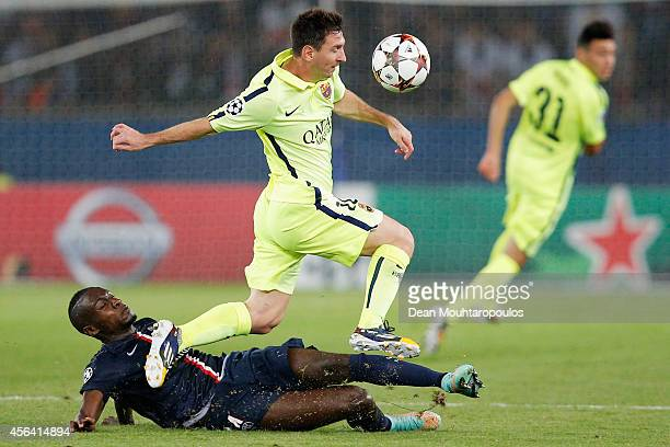 Lionel Messi of Barcelona skips the takle from Blaise Matuidi of PSG during the Group F UEFA Champions League match between Paris SaintGermain v FC...