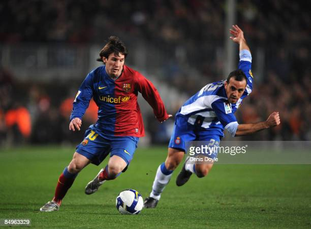 Lionel Messi of Barcelona speeds past Moises Hurtado of Espanyol during the La Liga match between Barcelona and Espanyol at the Camp Nou stadium on...