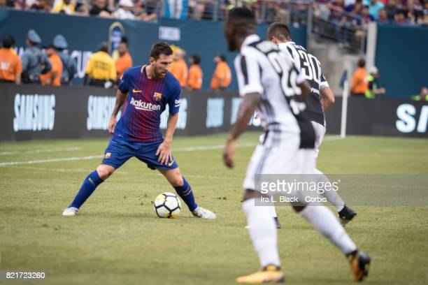 Lionel Messi of Barcelona takes a moment before advancing against Kwadwo Asamoah of Juventus and Rodrigo Bentancur during the International Champions...