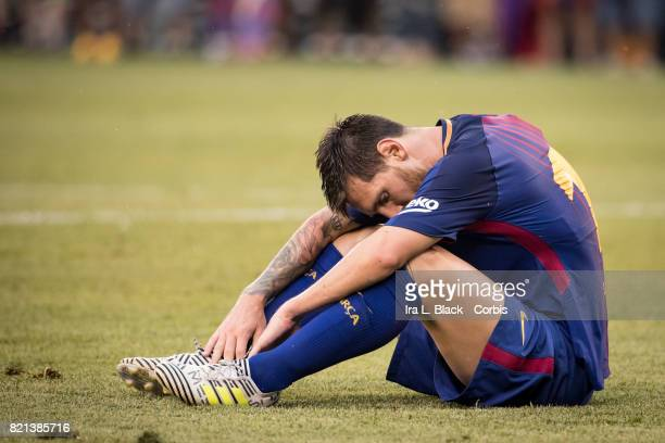 Lionel Messi of Barcelona takes a moment on the ground after a hit during the International Champions Cup match between FC Barcelona and Juventus at...