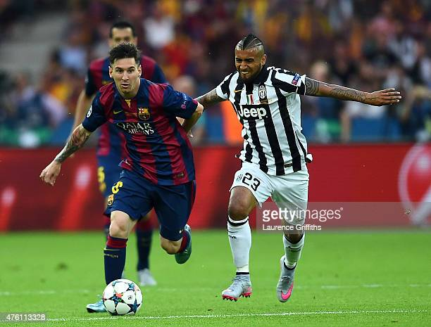 Lionel Messi of Barcelona takes on Arturo Vidal of Juventus during the UEFA Champions League Final between Juventus and FC Barcelona at...
