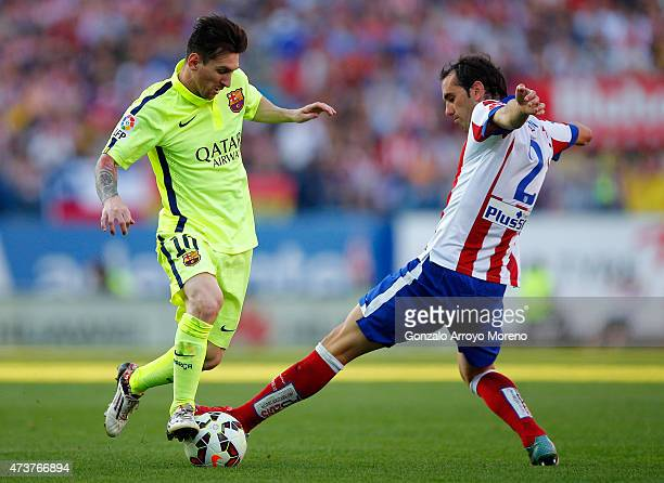 Lionel Messi of Barcelona takes on Diego Godín of Atletico Madrid during the La Liga match between Club Atletico de Madrid and FC Barcelona at...