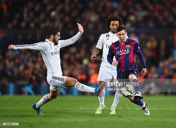 Lionel Messi of Barcelona takes on Isco and Marcelo of Real Madrid CF during the La Liga match between FC Barcelona and Real Madrid CF at Camp Nou on...