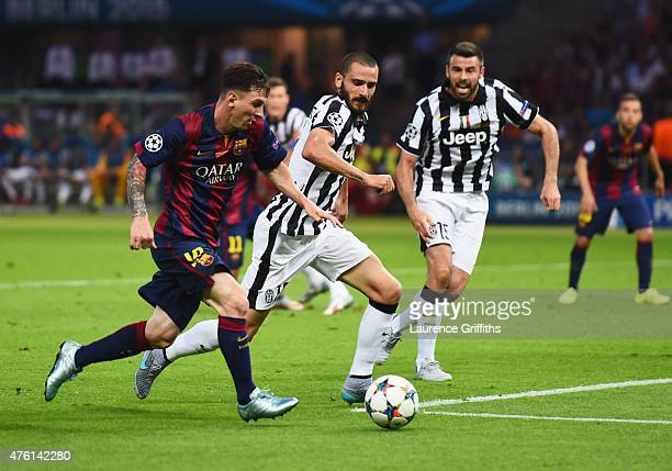 Lionel Messi of Barcelona takes on Leonardo Bonucci and Andrea Barzagli of Juventus during the UEFA Champions League Final between Juventus and FC...