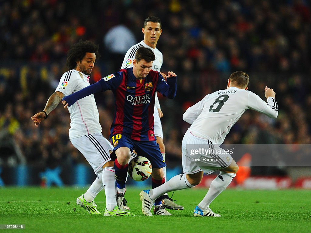 Lionel Messi of Barcelona takes on Marcelo (L), Cristiano Ronaldo (2R) and Toni Kroos of Real Madrid CF (R) during the La Liga match between FC Barcelona and Real Madrid CF at Camp Nou on March 22, 2015 in Barcelona, Spain.