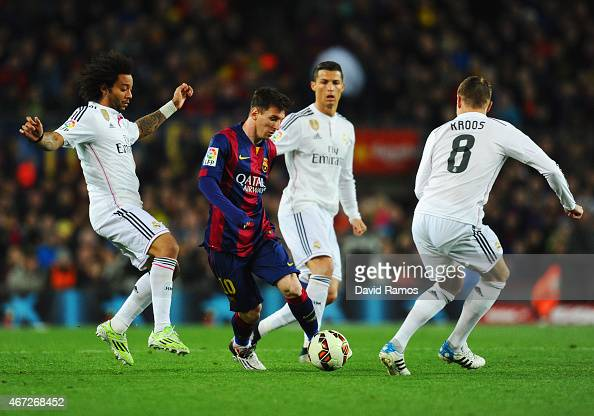 Lionel Messi of Barcelona takes on Marcelo Cristiano Ronaldo and Toni Kroos of Real Madrid CF during the La Liga match between FC Barcelona and Real...