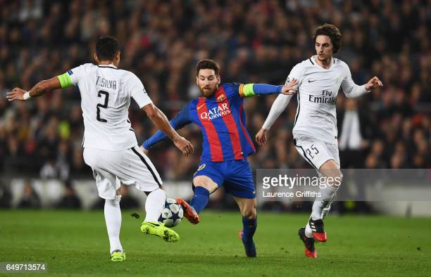 Lionel Messi of Barcelona takes on Thiago Silva and Adrien Rabiot of PSG during the UEFA Champions League Round of 16 second leg match between FC...