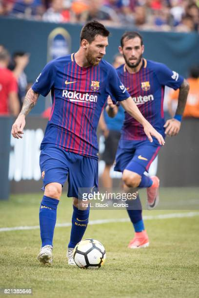 Lionel Messi of Barcelona takes the lead with Aleix Vidal of Barcelona behind him on the advance during the International Champions Cup match between...