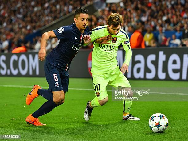Lionel Messi of Barcelona vies for ball with Marquinhos of Paris SaintGermain during the UEFA Champions League Quarter Final First Leg match between...