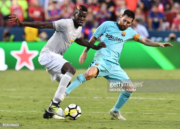 Lionel Messi of Barcelona vies for the ball with Paul Pogba of Manchester United during their International Champions Cup football match on July 26...