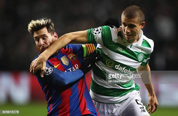 Lionel Messi of Barcelona vies with Jozo Simunovic of Celtic during the UEFA Champions League match between Celtic FC and FC Barcelona at Celtic Park...