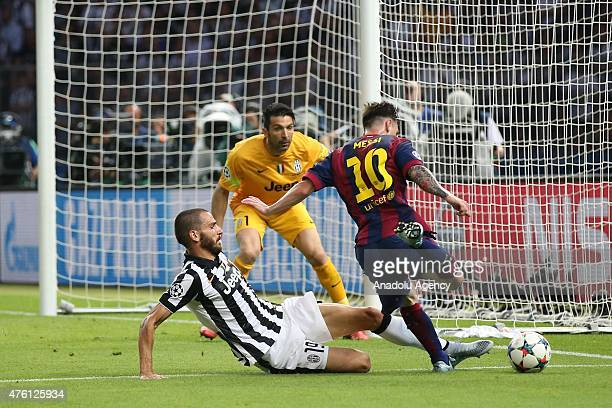Lionel Messi of Barcelona vies with Leonardo Bonucci and Gianluigi Buffon of Juventus during the UEFA Champions League Final between Juventus and FC...