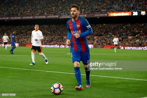 Lionel Messi of Barcelona walks on the pitch during the La Liga match between FC Barcelona and Valencia CF at Camp Nou Stadium on March 19 2017 in...