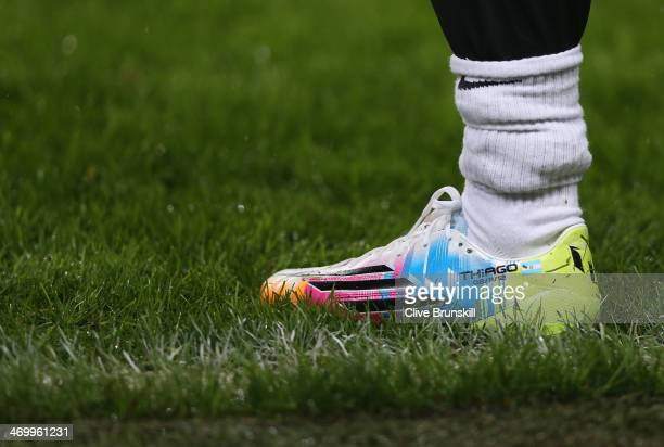 Lionel Messi of Barcelona wears rainbow coloured boots during a training session ahead of their UEFA Champions League Round of 16 match 1st leg...