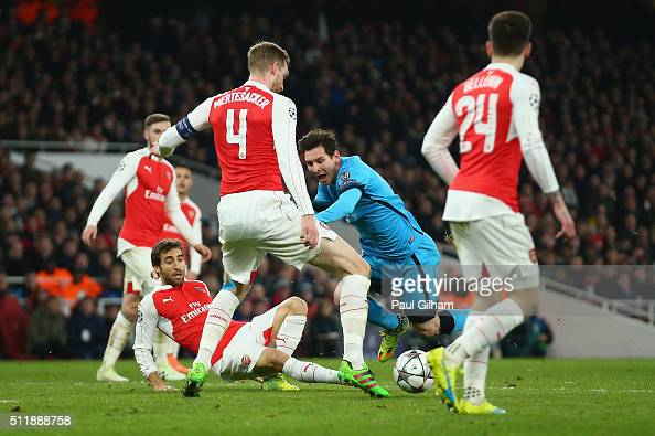 Lionel Messi of Barcelona wins a penalty during the UEFA Champions League round of 16 first leg match between Arsenal and Barcelona on February 23...