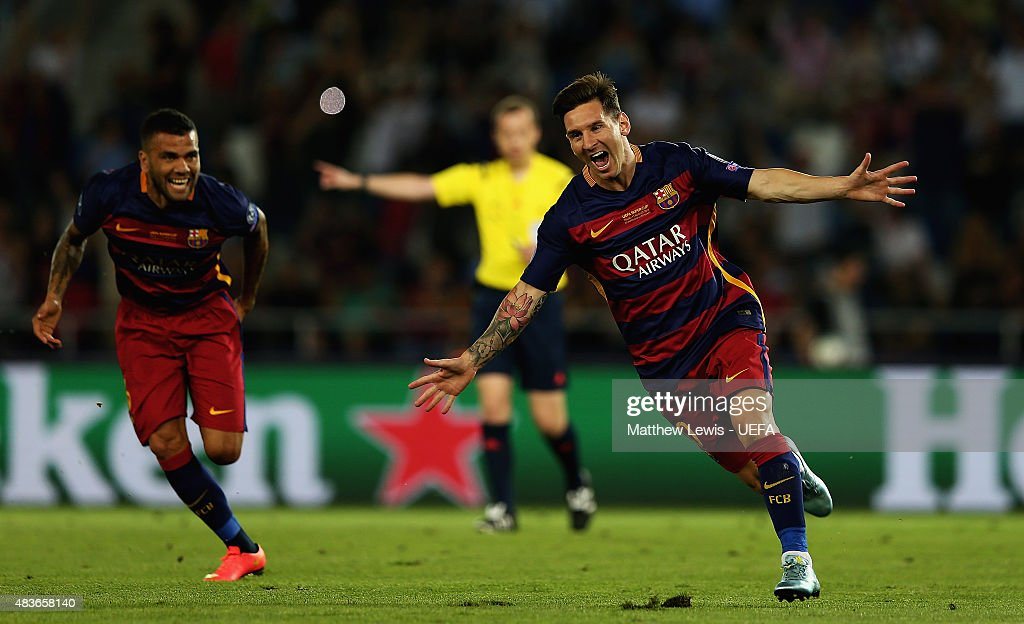 Lionel Messi of Barcelonacelebrates scoring his second goal by team mates during the UEFA Super Cup between Barcelona and Sevilla FC at Dinamo Arena...