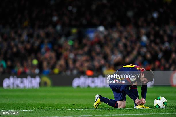Lionel Messi of FC Barcelona adjust his boots during the Copa del Rey Semi Final second leg between FC Barcelona and Real Madrid at Camp Nou on...