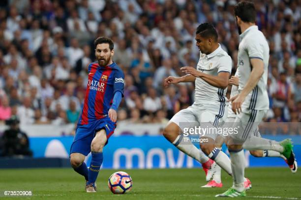 Lionel Messi of FC Barcelona and Casemiro of Real Madrid battle for the ball during the La Liga match between Real Madrid CF and FC Barcelona at the...