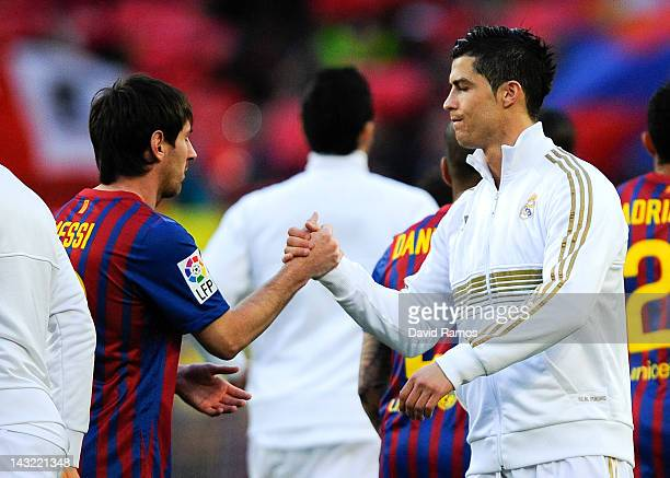 Lionel Messi of FC Barcelona and Cristiano Ronaldo of Real Madrid CF shake hands prior to the La Liga match between FC Barcelona and Real Madrid at...