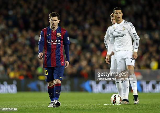 Lionel Messi of FC Barcelona and Cristiano Ronaldo of Real Madrid look on during the La Liga match between FC Barcelona and Real Madrid CF at Camp...