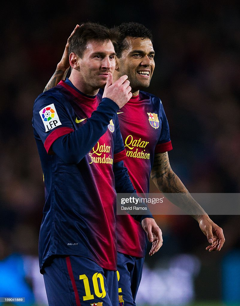 Lionel Messi of FC Barcelona (L) and Dani Alves of FC Barcelona reacts during the La Liga match between FC Barcelona and RCD Espanyol at Camp Nou on January 6, 2013 in Barcelona, Spain.